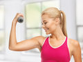 Young sporty woman with light dumbbell Stock Images