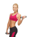 Young sporty woman with light dumbbells picture of Royalty Free Stock Photos