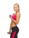 Young sporty woman with light dumbbells picture of Stock Photos