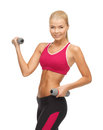 Young sporty woman with light dumbbells picture of Royalty Free Stock Image