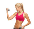 Young sporty woman with light dumbbells picture of Royalty Free Stock Photography