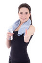 Young sporty woman thumbs up with bottle of mineral water isolat isolated on white background Stock Image