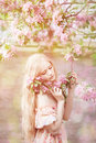 Young spring fashion woman  in spring garden. Springtime. Trendy Royalty Free Stock Photo