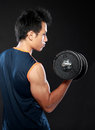 Young strength man portrait of lifting dumbbell Stock Images