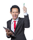 Young Stressed business man holding tablet and pen Royalty Free Stock Photo