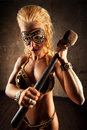 Young strong woman with hammer Royalty Free Stock Image