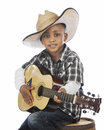 Young Strumming Cowboy Royalty Free Stock Photo