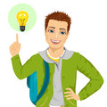 Young student boy pointing finger to light bulb having an idea