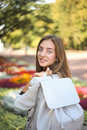 Young student girl with white leather bag in park Royalty Free Stock Photo
