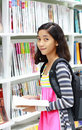 Young student in the library Royalty Free Stock Photo