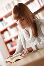 Young student in a library Royalty Free Stock Images