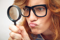 Young student looking through magnifying glass. Royalty Free Stock Photo