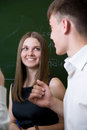 Young student looks at companion and smiles Royalty Free Stock Photo