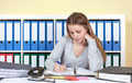 Young student at office writing a message woman on paper Royalty Free Stock Image