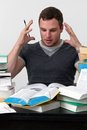 Young Student overwhelmed with studying Royalty Free Stock Photo