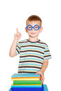 Young student pointing finger upward little boy wearing glasses with books a elementary school a isolated on white background Royalty Free Stock Photos