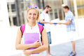 Young student standing and smiling in the campus a picture of a Stock Photo