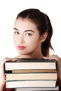 Young student woman eith stack of books Stock Photography
