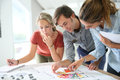 Young students of architecture working on color designs Royalty Free Stock Photo