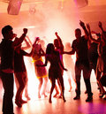 Young students dancing with joy in a disco Royalty Free Stock Photos