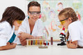 Young students watching an experiment in elementary science clas Royalty Free Stock Photo