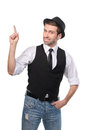 Young stylish caucasian man pointing with his finger upwards. Royalty Free Stock Photo