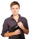Young  stylish haircutter holding hairdryer. Royalty Free Stock Photo