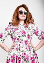 Young stylish red-haired woman with curly hair and pretty face posing in sunglasses. expresses different emotions Royalty Free Stock Photo