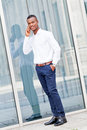 Young successfil african businessman with mobilephone talking walking outdoor Royalty Free Stock Images