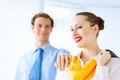 Young successful business woman women smiling a colleague put his hand on her shoulder Stock Photo
