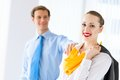 Young successful business woman women smiling a colleague put his hand on her shoulder Stock Photography