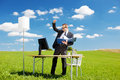 Young successful businessman raising his hands over the blue sky Royalty Free Stock Images