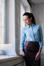 Young successful happy smiling business woman on laptop Royalty Free Stock Photo
