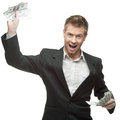 Young successful screaming businessman holding money caucasian in black suit isolated on white Royalty Free Stock Images