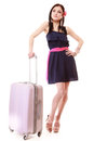 Young summer girl with travel suitcase isolated full length of fashion woman pink luggage bag looking at wrist watch on white Stock Photos