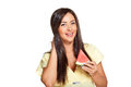 Young sun tanned woman with slice of watermelon dressed in a lite summer yellow dress holding smiling and looking at the camera Royalty Free Stock Photos