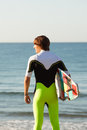 Young surfer about to get into the sea Royalty Free Stock Photo
