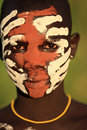 Young suri warrior with face painting beautiful at a ceremony in south omo ethiopia Royalty Free Stock Photography