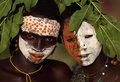 Young suri warriors with face painting and flower decoration at a ceremony in south omo ethiopia Stock Photo