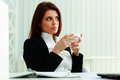 Young surprised businesswoman holding cup Royalty Free Stock Photo