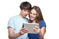 Young surprised couple with digital tablet closeup of against white background Royalty Free Stock Images