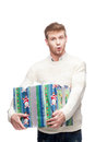 Young surprised man holding big heavy gift Royalty Free Stock Photos