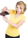 Young surprised unhappy puzzled woman girl holding an empty wallet a close up picture of a cute isolated on a white background Royalty Free Stock Image