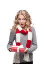 Young surprised woman holding christmas gift Royalty Free Stock Images