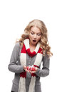 Young surprised woman holding christmas gift Stock Photo