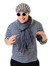 Young suspicious looking stylish twister man in striped clothes isolated on white background Stock Image