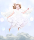 Young sweet angel flying Royalty Free Stock Photo