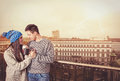 Young sweet romantic couple drinking coffee standing on terrace