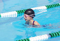 Young swimmer at swim meet a competing in the breaststroke a Stock Image