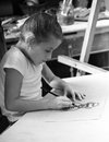 Young talented girl artist charcoal drawings Stock Photos